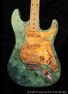 """""""Mr. Mojito""""  Mixed-media artwork on functioning electric guitar.  Created by Erin Fahey and Eric Cooke of evendesign"""