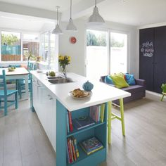 White-open-plan-kitchen-with-blue-furniture