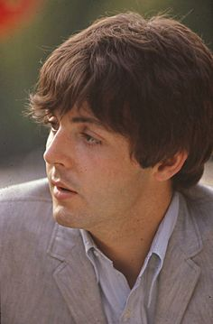 Paul McCartney participates in a photo session with the Beatles after their Paris concerts in France, photographed by Jean-Marie Périer. (June 21st, 1965)