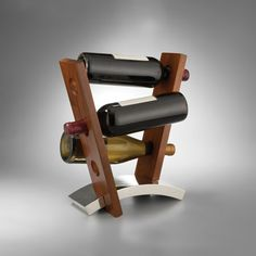 Nambe Joust Wine Rack, Holds 6 Bottles Turn lowly bottles into sculpture with this handsome wine rack. When you buy this piece, your reds and whites will be Wine Bottle Holders, Glass Holders, Wine Bottles, Wood Concrete, Wine Rack Design, Bed Bath & Beyond, Wine Rack Plans, Barrel Furniture, Wood Wine Racks