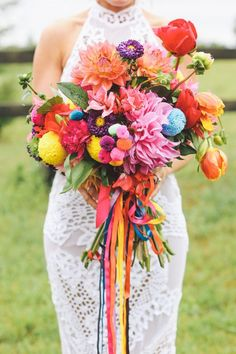 Lovely bright bridal bouquet perfect for a festival style wedding day.-- I would totally use this as the bouquet I toss (since I don't want my real bouquet to be made with flowers) Summer Wedding Bouquets, Boho Wedding, Dream Wedding, Wedding Day, Whimsical Wedding, Rainbow Wedding Dress, Bridal Bouquets, October Wedding, Summer Weddings
