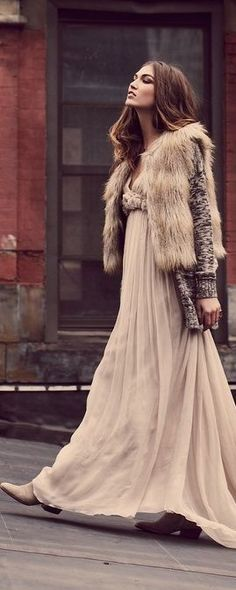 All romantic girls can be boho in their own way. You should wear a baby pink maxi dress, a grey sweater and a faux fur vest. Complete the beautiful look with cowboy boots and many golden rings.