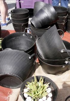 Recycled tire garden pots- I wonder if I could make these