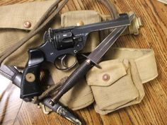 Enfield No. 2 revolver and Fairbairn–Sykes fighting knife (made famous by the WWII British commandos and SAS)