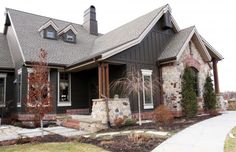 Cottage rustic with stone and board and batten. Gray exterior.