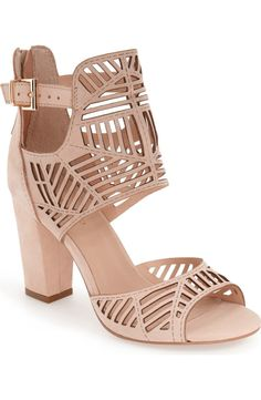 How fierce are these caged sandals? Geometric cutouts and a chunky block heel take this look to the next level.