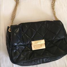 Black Michael Kors quilted bag ✨PRICE IS FIRM✨Black michael kors quilted with gold chain can be worn crossbody or just adjust to shorter length for shoulder. Good condition. Tons of space. Can dress up or down. Cleaning out my closet. Sad to let this go one of my fave bags. Needs a new home. NO TRADE NO PAYPAL ✨PRICE IS FIRM✨ Michael Kors Bags