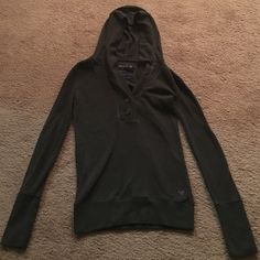 Jr.'s Long Sleeve Gray Hooded Top Dark Gray - thermal type top with hood. Has 2 buttons in front American Eagle Outfitters Tops Sweatshirts & Hoodies