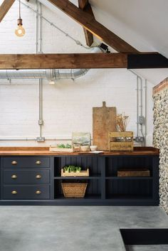 Dark cabinets are so on trend right now and opting for open cupboards allows you to show off your favourite bits of kitchenware and keep them in an easy to see spot!