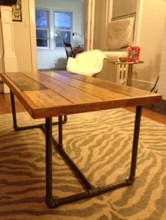 DIY Industrial style coffee table. With instructions and materials used. I especially love the way the planks are 'framed' on the top. Made from plumbing parts and timber planks.  DIY industrial furniture tutorial