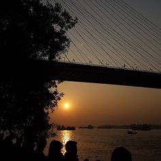 The Classic moment of dusk during sunset is more looking with Vidyasagar Setu of Ganges!!!! Post by @atif___ahmed