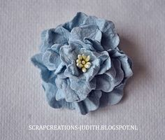 Blog Tutorial on how to make these beautiful flowers using Mulberry Paper, Stormy Sky Distress ink and a Die