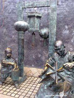 Fuzhou, Fuchien China.  Statues on a street that meant if you did business there you would have fame and fortune.
