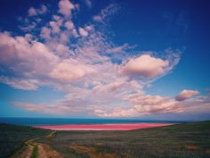 Lake Hillier, located in Australia's Rechercha Archipelago, is not the only pink lake to exist, but while other pink lakes change colors in different temperatures, Lake Hillier maintains the same color year-round, even when bottled. The cause of the color remains undetermined, though some say it could be the result of its high salt content combined with the presence of a pink bacteria species.