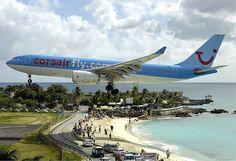 Planes landing at the Princess Juliana Airport, St. Maarten - Corsair.