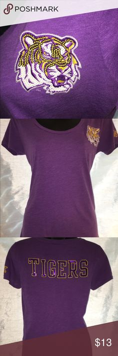 PINK Victoria's Secret Collegiate Top- LSU Tigers Support your favorite team in this Lousiana State University Collegiate Top. Classic LSU Tigers colors: Purple & Gold.  Excellent condition. This is a pre-owner top with very little wear. No sequins missing.  Get your BLING on! VS PINK 🐕 #GeauxTigers PINK Victoria's Secret Tops Tees - Short Sleeve