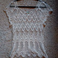 Cream crochet open knit top Super cute cream crochet open knit short sleeve top. Size large but could fit medium too. Charlotte Russe Tops