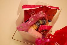 candy necklaces and rings, candy lipsticks, pink and white hard candies and Barbie fruit snacks