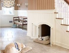 Another underutilized area in the home is the space under a staircase. An arched doorway makes this dog den even more special.  Remember doors should always be constructed of a material that allows airflow so it's more comfortable for them.