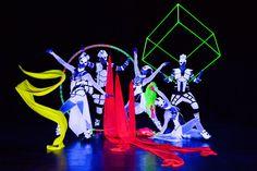Black light dancers Anta Agni in Crystal Light Show. Cyr wheels, cubes, ribbons, led props.