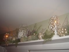 Decorated Christmas shelf above door in sage, purple and white