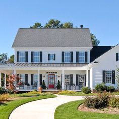 Colonial with a front porch addition....lovely...