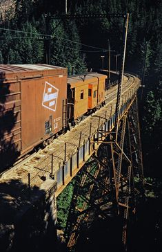 MILW, Hall Creek, Washington, 1979 Caboose of westbound Milwaukee Road freight train crossing bridge in Hall Creek, Washington, on July 14, 1979. Photograph by John F. Bjorklund, © 2016, Center for Railroad Photography and Art. Bjorklund-68-11-12