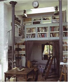 Books, books, books. . . and a bed in a hidey-hole!