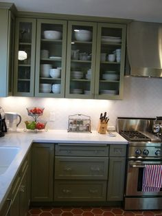 Love the backsplash, glass doors and yes, the green cabinets too!! Thinking about doing this, but with gray cabinets!