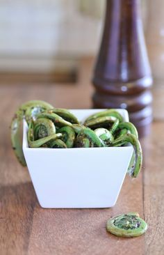 Fiddleheads, sauteed with garlic in butter, steamed in white wine and then drizzled with lemon juice and olive oil before serving.