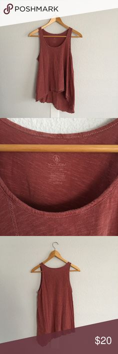 Volcom Rust Asymmetrical Flowy Tank Top Volcom Rust Asymmetrical Tank Top in great condition. I have only worn this a couple of times. Reinforced raw hemline. Flat lay measurements are as follows. Chest: 16 inches. Side seam measures 15 inches. Bundle and save! Offers are always welcome. A220183 Volcom Tops Tank Tops