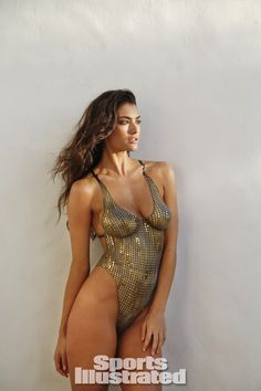 Lauren Mellor Swimsuit Body Paint - Sports Illustrated Swimsuit 2014 - SI.com Photographed by Walter Iooss Jr. in St. Lucia. Swimsuit inspired by Maui Girl by Debbie Wilson from the 1992 Monika Tilley Swim suit.