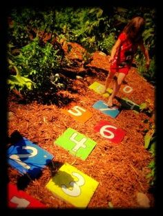 Something to brighten up your outside play area. Variations: letters, names, or shapes instead of numbers.