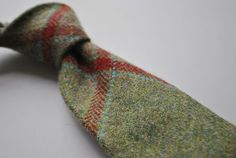 Henry Harris tweed tie in green with maroon, pink & blue check RRP