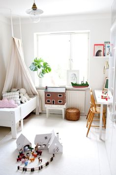 clean and modern kids room with lots of play space, modern toys and natural lighting