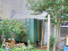 Before - 2011. The old oil tank, behind which was built our storage area.