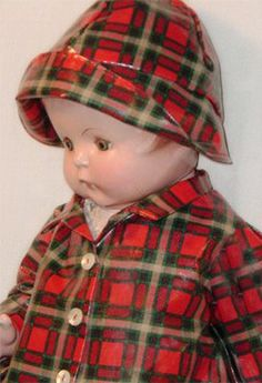 Vintage doll 'Patsy Ann' in her tartan rain coat and hat.