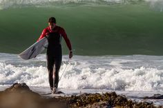 Urban Beach's Tom Butler coming out of the surf #wetsuits #surf | http://www.urbanbeach-surf.co.uk/