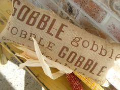 Gobble Gobble Gobble Thanksgiving Burlap Pillow. $28.00, via Etsy.