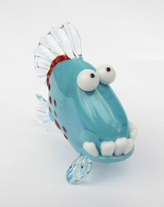 Funny Glass Fish Sculpture. This turquoise glass fish sculpture #2 measures 60mm long by 55mm tall.