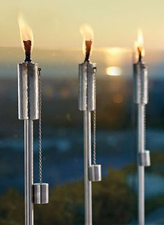 Light steps, pathways, and lawns with these cool, contemporary Soho Stainless Steel Torches.