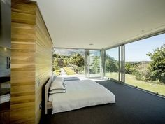 Wall-to-floor glass windows in the master bedroom with panoramic views over the Constantia Valley and False Bay! Meanwhile, you're able to enjoy the mountain backdrop! Amazing architectural design!  #Constantia #luxury