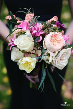 Pink and white bridesmaid bouquet with garden roses, tulips, and lilies | Lindsay Hite of Readyluck | Brides.com