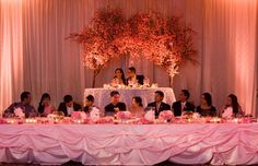 Cherry blossom head table: We put our wedding party (and their dates) on display.  Tip: Ask nicely to have their dates dress in similar wedding party colors.  Nothing is more awkward then being the girl wearing bright blue in a picture with all pink