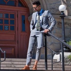 Camo tie and gray suit.