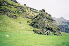 An old stone storage house built into the side of a mountain, Iceland. By Mei Burgin
