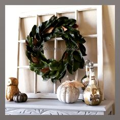 My inspired magnolia wreath I did for my dining room in our new home. Window frame pier 1, Camilleri Bottles and pumpkins from Z Gallerie, and gold owl fro Home Goods