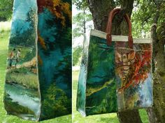 Sew a tote bag from an old thrift store oil painting.  Interesting idea.  The leather handles are a bit tricky....