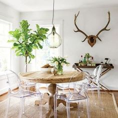 Updated Bungalow: The Dining Room - love the combination of the wood table with ghost chairs