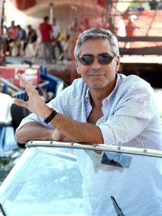 George Clooney kicks back on a boat in Venice, Province of Vicenza , Veneto region Italy